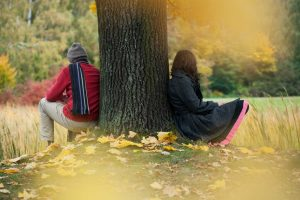 Man And Woman Contemplating In The Autumn Park